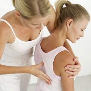 Massage therapist giving therapeutic massage therapy