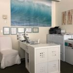 Office with picture of waves on far wall.