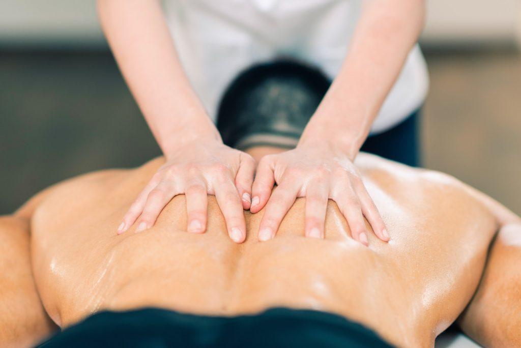 Sports massage. Therapist massaging sportsman's back